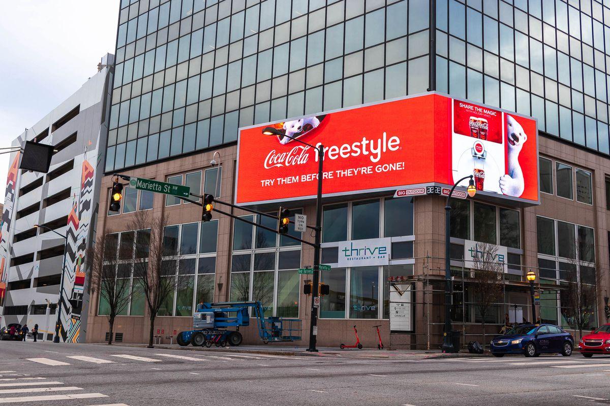 Lighted billboard featuring Coca-Cola ad.