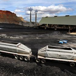 A truck arrives to dump coal at the Huntington power plant in Huntington on Tuesday, March 24, 2015.