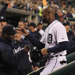 Detroit Tigers' Austin Jackson greets teammates after scoring in the first inning of the second baseball game of a doubleheader against the Minnesota Twins at Comerica Park in Detroit, Sunday, Sept. 23, 2012.
