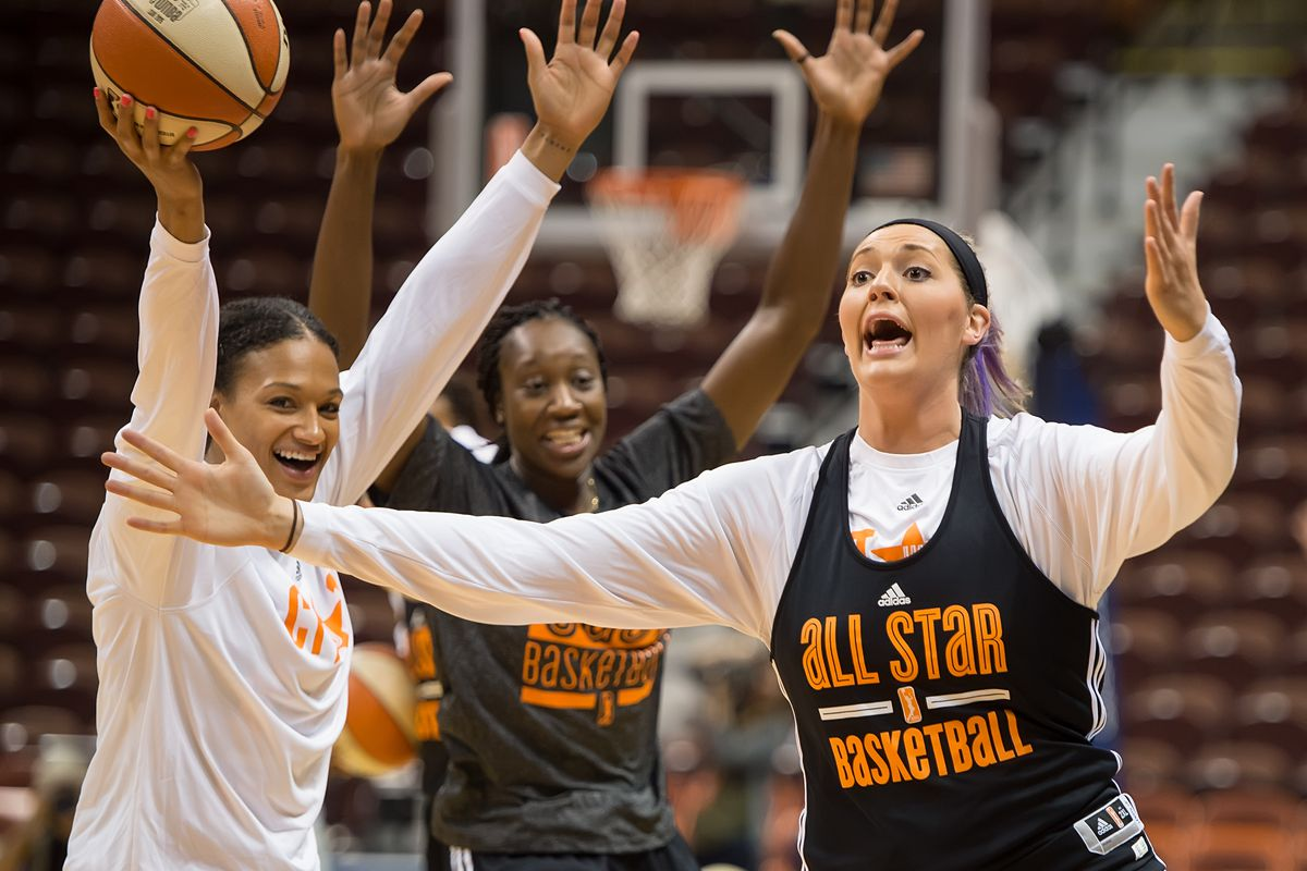 Stefanie Dolson reacts to making a half-court shot during the WNBA All-Star Open Practice