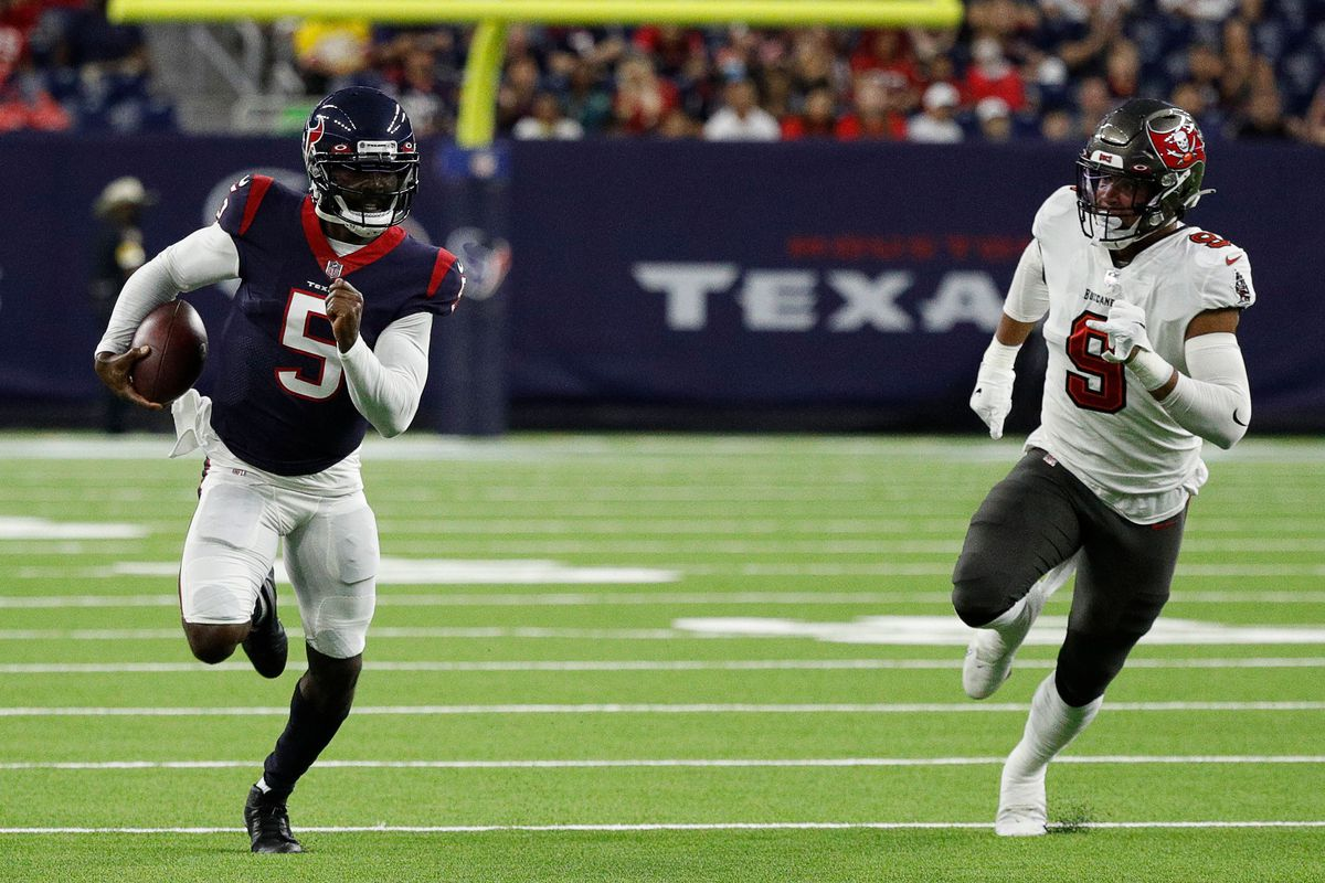 Tyrod Taylor #5 of the Houston Texans avoids a tackle attempt by Joe Tryon-Shoyinka #9 of the Tampa Bay Buccaneers in the first half during a NFL preseason game at NRG Stadium on August 28, 2021 in Houston, Texas.