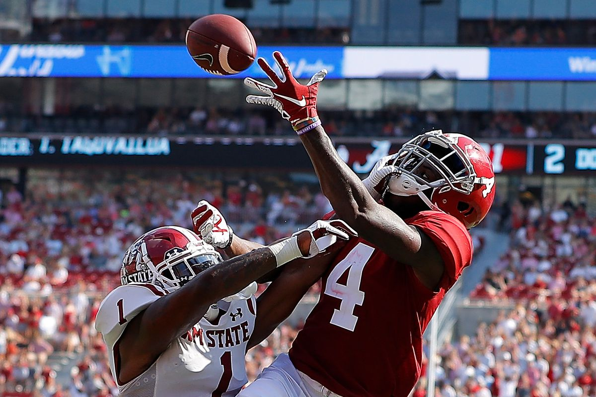 Jerry Jeudy #4 of the Alabama Crimson Tide fails to pull in this reception as he is defended by Ray Buford Jr. #1 of the New Mexico State Aggies at Bryant-Denny Stadium on September 07, 2019 in Tuscaloosa, Alabama.