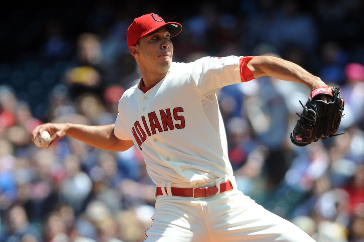 May 6, 2012; Cleveland, OH, USA: Cleveland Indians starting pitcher Ubaldo Jimenez (30) throws a pitch during the first inning against the Texas Rangers at Progressive Field.  Mandatory Credit: Eric P. Mull-USPRESSWIRE