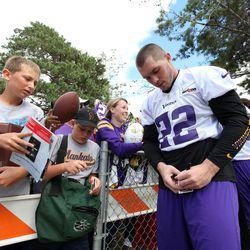 Jul 26, 2013; Mankato, MN, USA; Minnesota Vikings safety Harrison Smith (22) signs autographs for fans during training camp at Minnesota State University. Mandatory Credit: Brace Hemmelgarn-USA TODAY Sports
