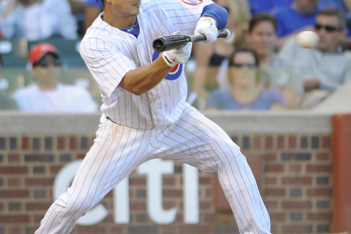 Darwin Barney of the Chicago Cubs lays down a sacrifice bunt against the Pittsburgh Pirates at Wrigley Field in Chicago, Illinois. (Photo by David Banks/Getty Images)