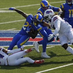 Buffalo Bills' Taron Johnson, left, and Vernon Butler, right, tackle Los Angeles Rams' Darrell Henderson during the second half of an NFL football game Sunday, Aug. 26, 2018, in Orchard Park, N.Y.
