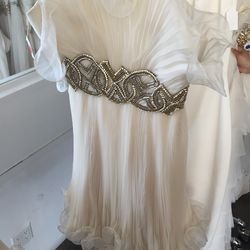 Silk pleated cocktail dress in cream, $600