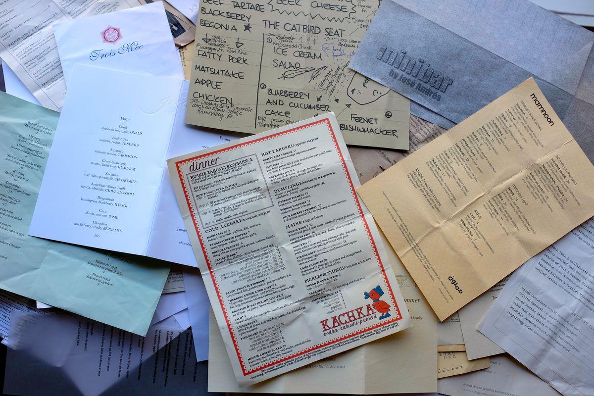 a big pile of paper menus
