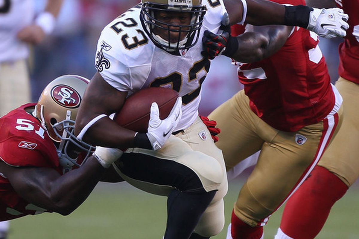 SAN FRANCISCO - SEPTEMBER 20:  Pierre Thomas #23 of the New Orleans Saints runs against the San Francisco 49ers during an NFL game at Candlestick Park on September 20 2010 in San Francisco California.  (Photo by Jed Jacobsohn/Getty Images)