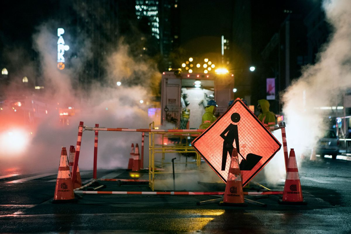 Utility workers at a manhole on Eighth Avenue in Midtown, Nov. 18, 2019.