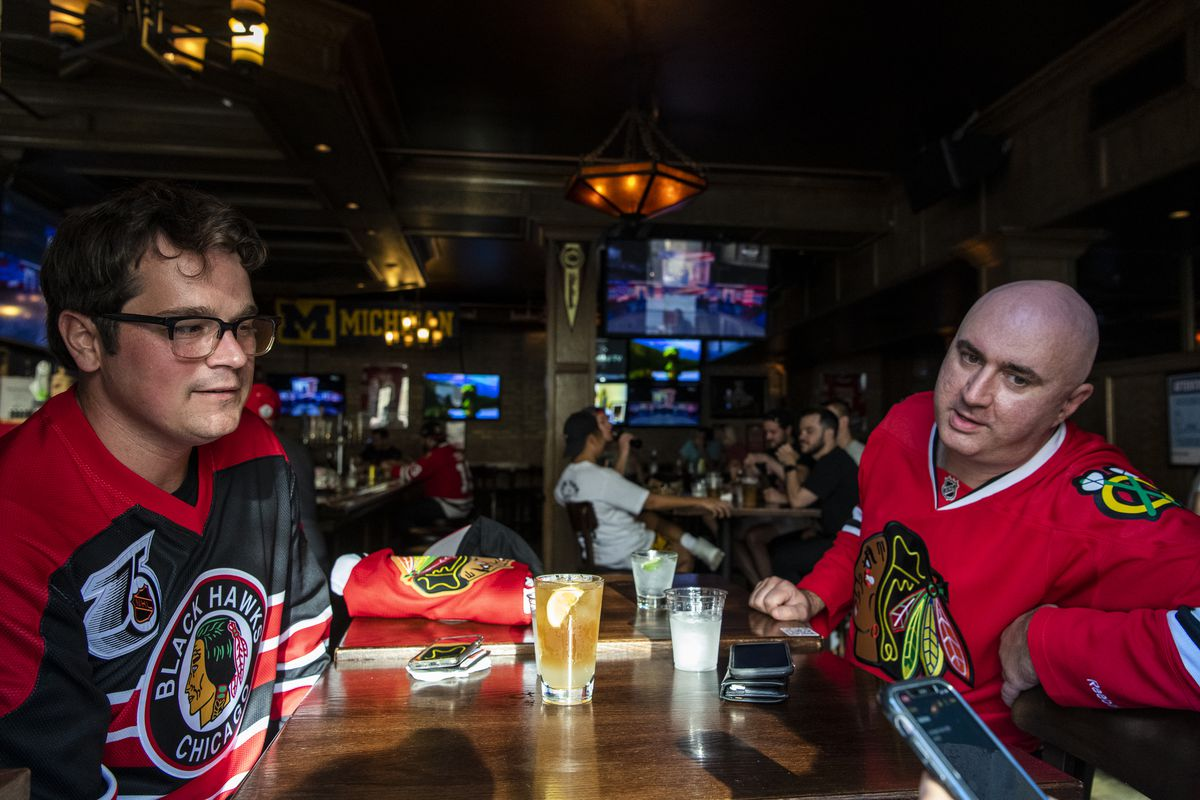 Chicago Blackhawks fans Jim Moore, left, and Tony Vittal enjoy a drink at WestEnd ahead of the Blackhawks game against the Edmonton Oilers, Friday, Aug. 7, 2020.