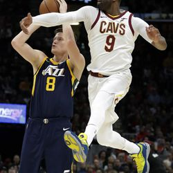 Utah Jazz's Jonas Jerebko (8), from Sweden, shoots against Cleveland Cavaliers' Dwyane Wade (9) in the first half of an NBA basketball game, Saturday, Dec. 16, 2017, in Cleveland. (AP Photo/Tony Dejak)