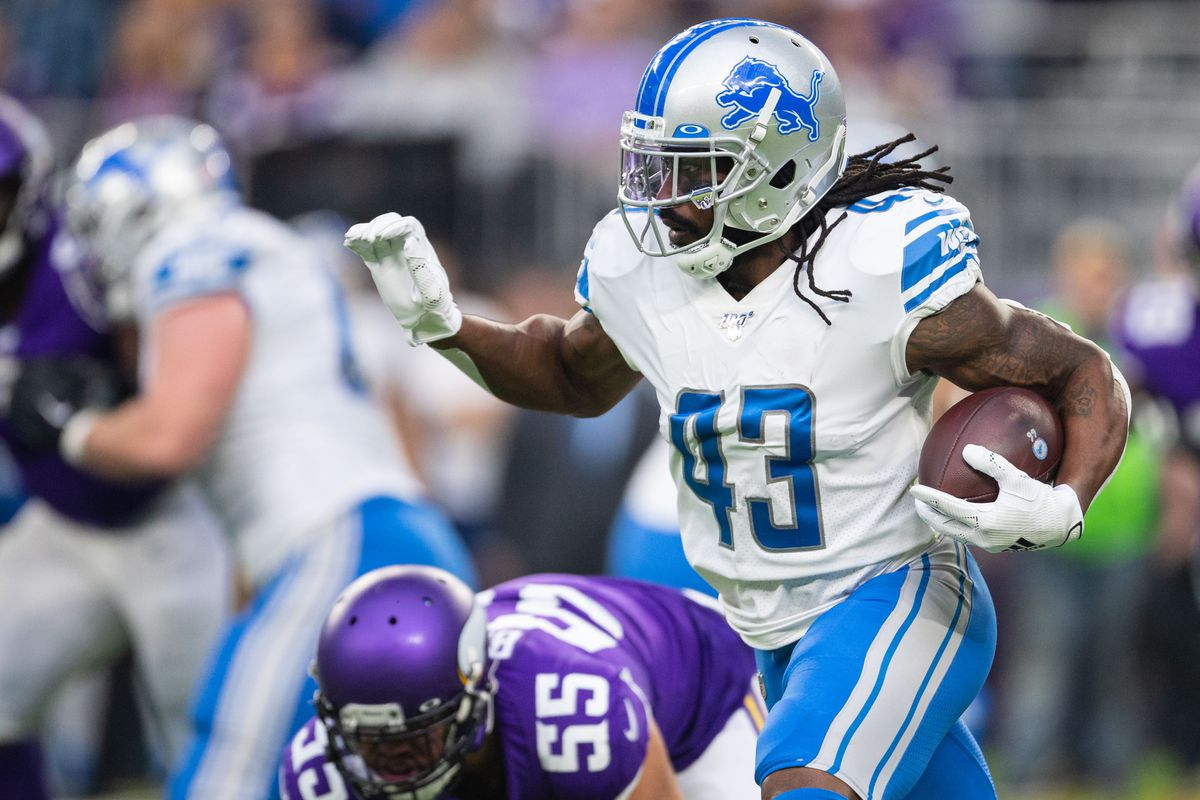 Detroit Lions running back Bo Scarbrough runs the ball during the first quarter against the Minnesota Vikings at U.S. Bank Stadium.
