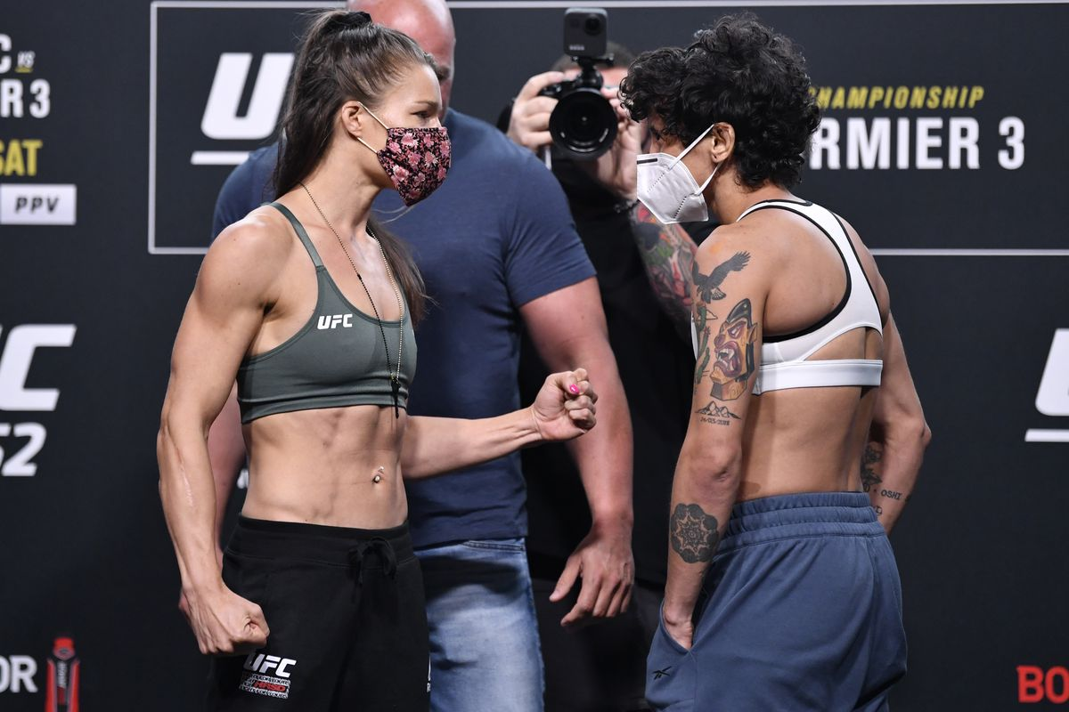 Opponents Felice Herrig and Virna Jandiroba of Brazil face off during the UFC 252 weigh-in at UFC APEX on August 14, 2020 in Las Vegas, Nevada.
