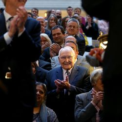Elder L. Tom Perry, a member of the Quorum of the Twelve Apostles of The Church of Jesus Christ of Latter-day Saints, applauds after Gov. Gary Herbert signed SB296 at the Capitol in Salt Lake City on Thursday, March 12, 2015.