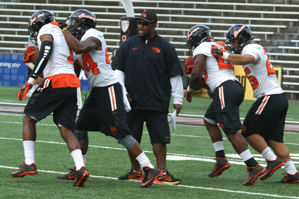 Telly Lockette oversees Oregon State running back drills.