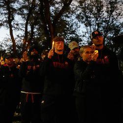 University of Utah athletes holds up candles during a candlelight vigil remembering the life of slain student-athlete Aaron Lowe on Wednesday, Sept. 29, 2021 at University of Utah in Salt Lake City.