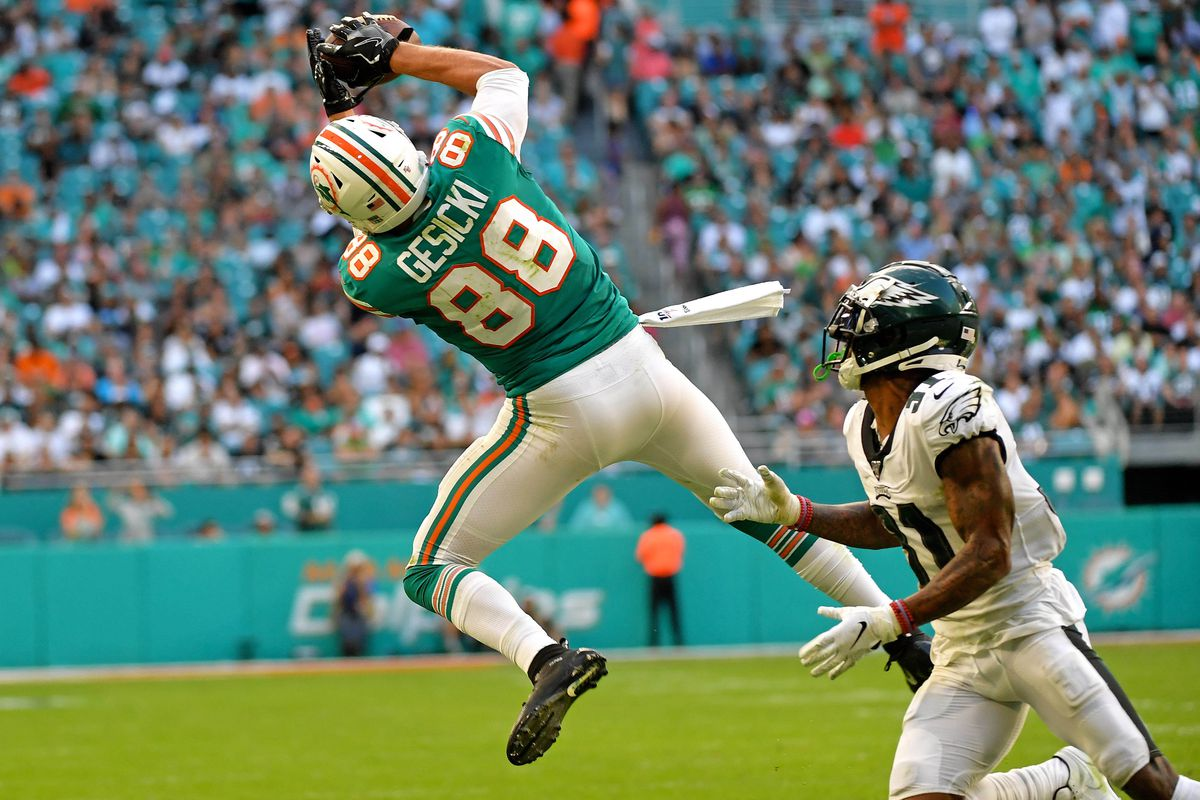 Miami Dolphins tight end Mike Gesicki makes a catch as Philadelphia Eagles cornerback Jalen Mills defends the play during the second half at Hard Rock Stadium.