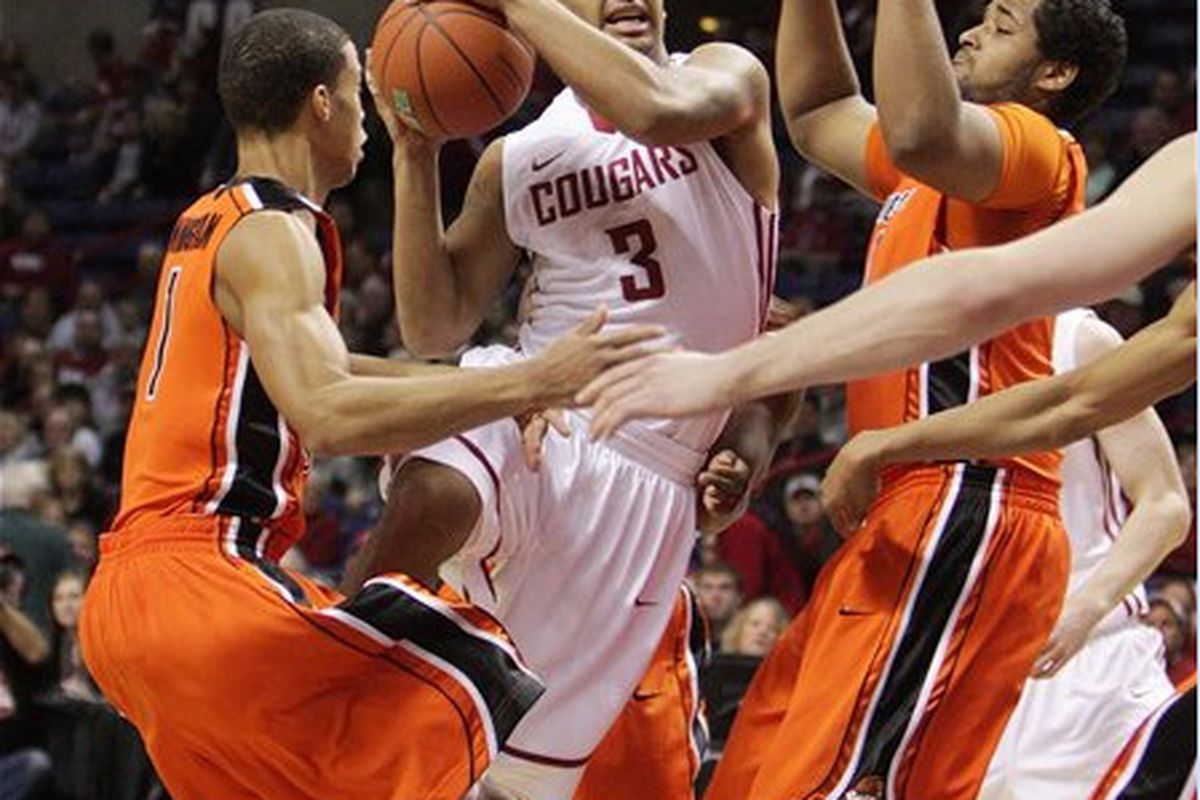 Washington St.'s DaVonte Lacy drives between Oregon St.'s Jared Cunningham (l.) and Joe Burton in the Cougars' 81-76 win over the Beavers on New Year's Eve in Spokane. How much of a factor will Lacy be in the rematch in Corvallis? <em>(AP Photo)</em>