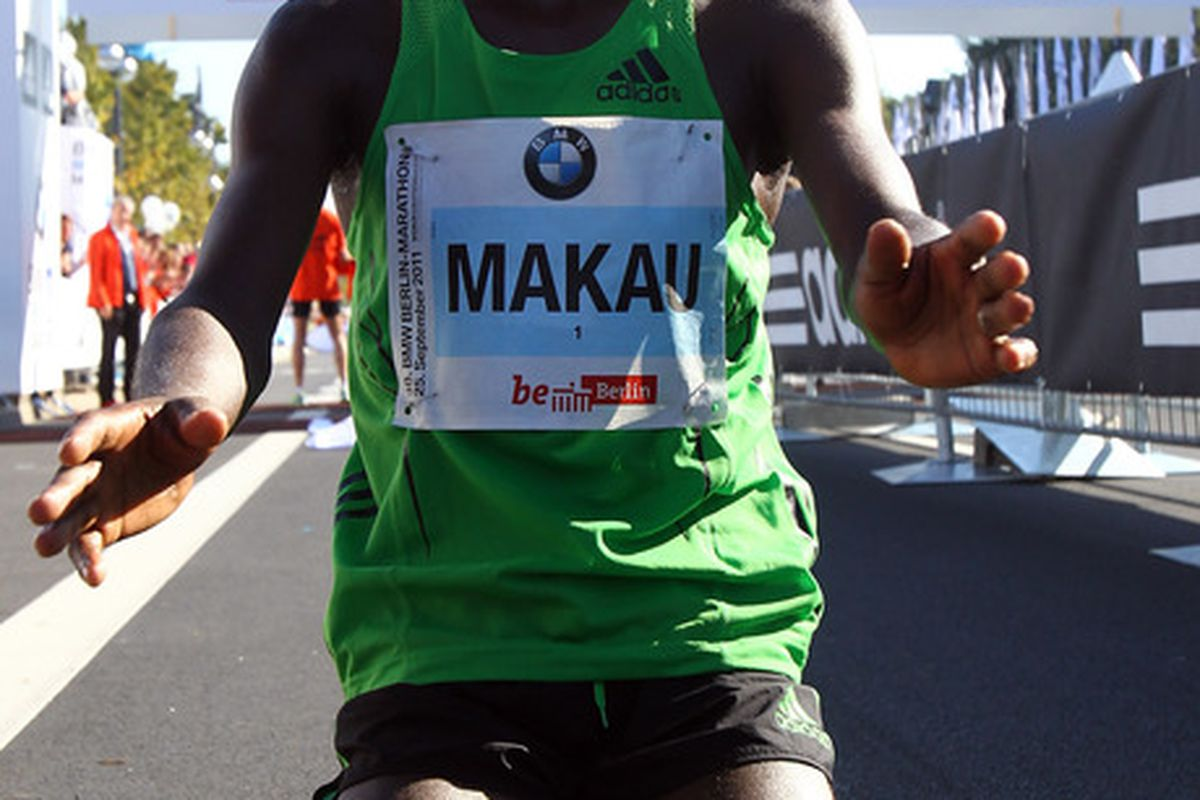 BERLIN, GERMANY - SEPTEMBER 25:  Patrick Makau of Kenia celebrates victory and a new world record during the BMW Berlin Marathon on September 25, 2011 in Berlin, Germany.  (Photo by Martin Rose/Bongarts/Getty Images)