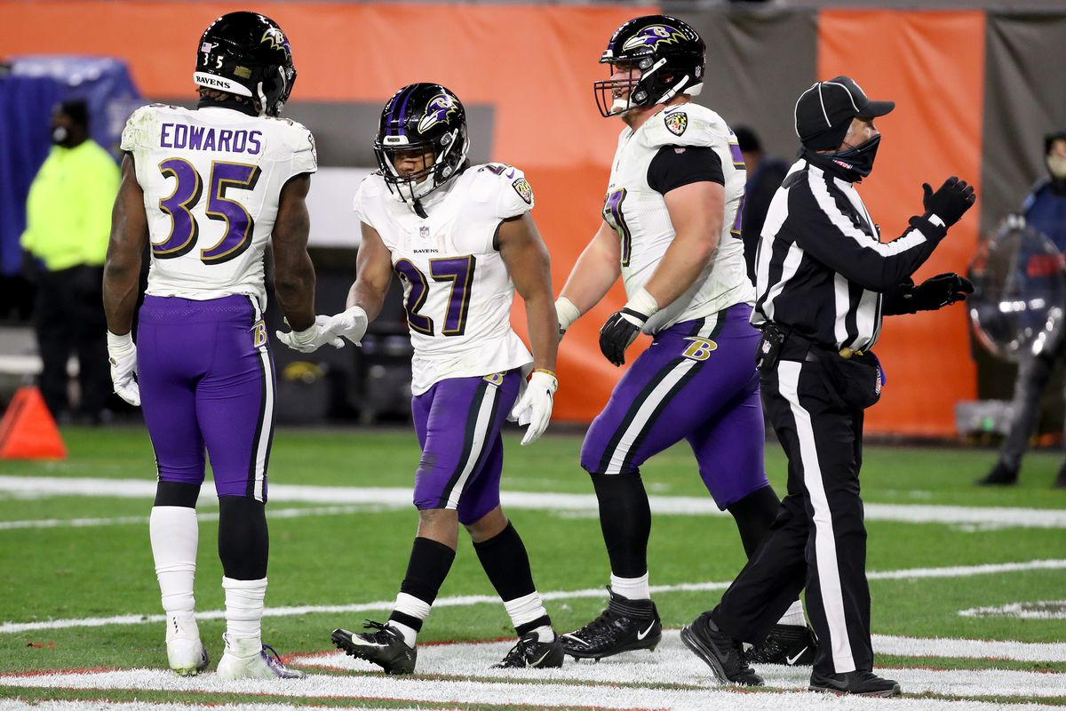 J.K. Dobbins #27 of the Baltimore Ravens celebrates a two-point conversion with Gus Edwards #35 during the fourth quarter in the game at FirstEnergy Stadium on December 14, 2020 in Cleveland, Ohio.