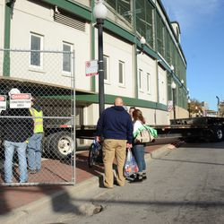 2:06 p.m. A flatbed truck backing in, under the marquee -