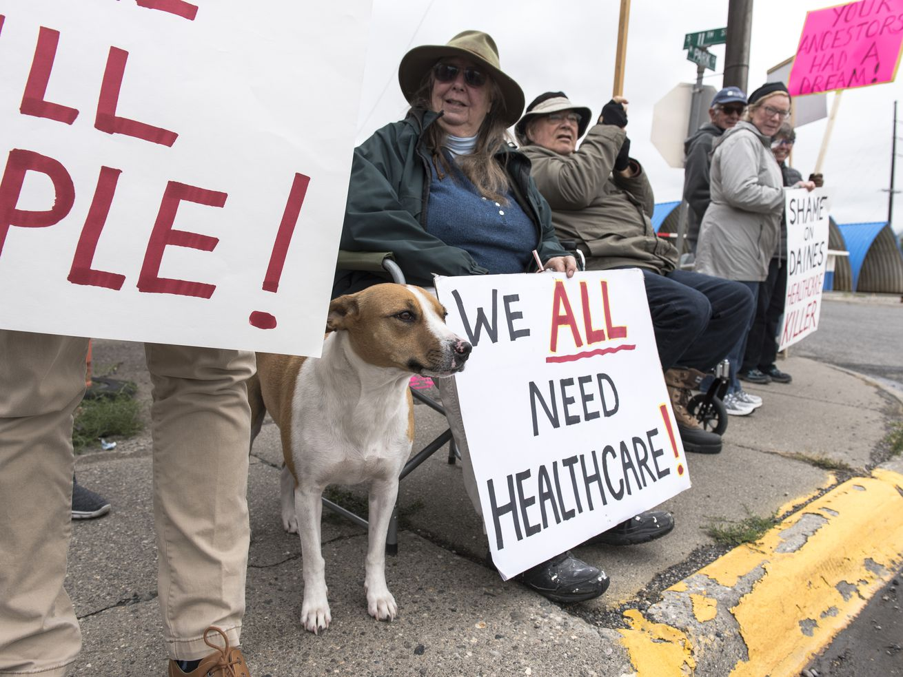 Protesters hold a small, peaceful demonstration in support of health care on September 23, 2017, in Livingston, Montana.