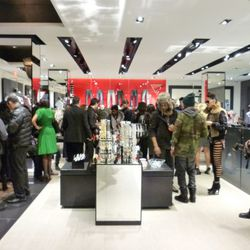 Guests gather on the second level where the menswear and accessories are located