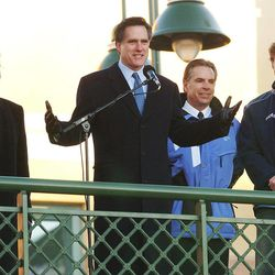 Mitt Romney, Gov. Mike Leavitt, left, SLOC official Frazier Bullock and Olympic medalist Joey Cheek talk to  SLOC volunteers at the Wall of Fame unveiling Feb. 7, 2003.