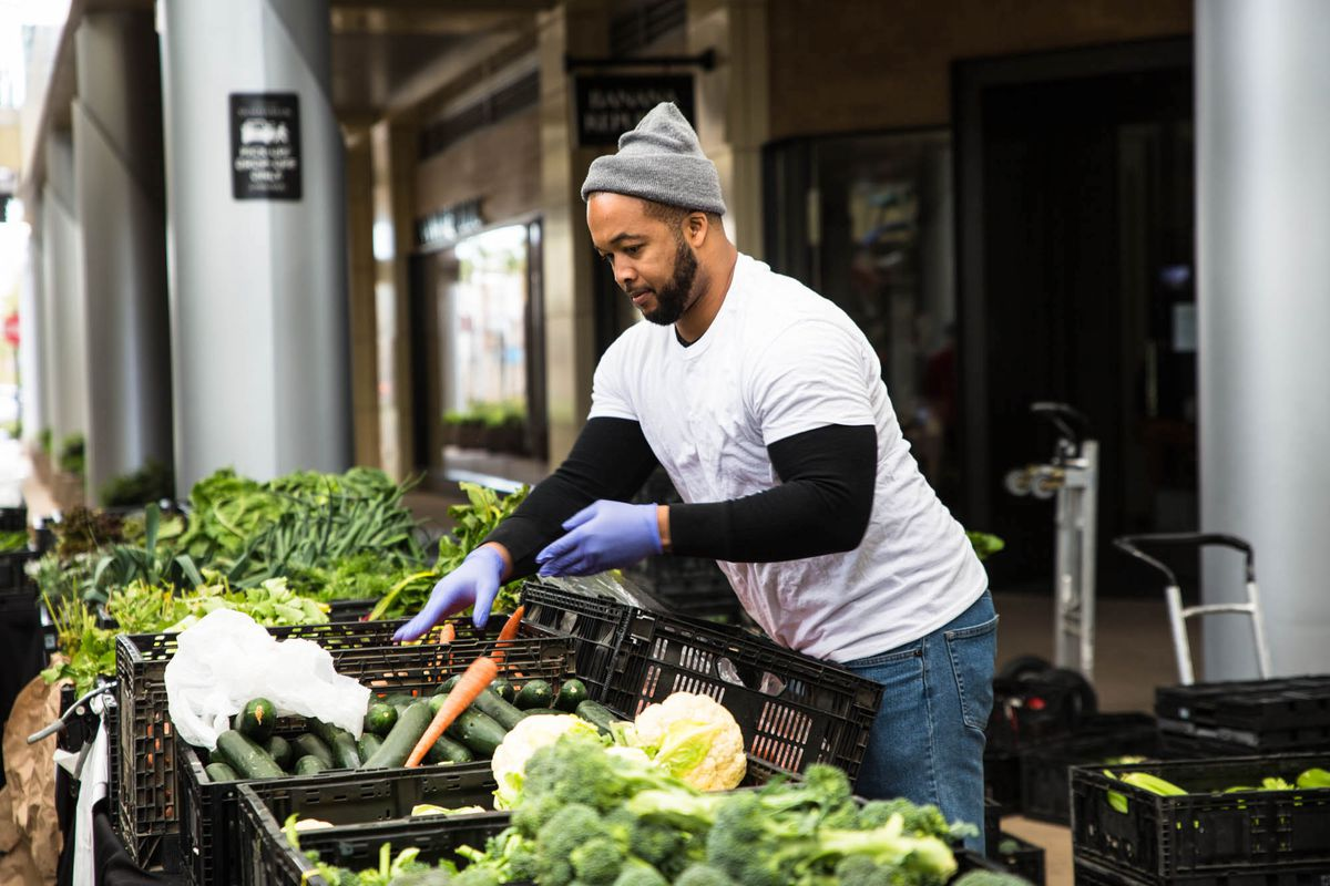An employee gathers an order at the Las Vegas Farmers Market at Downtown Summerlin