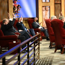 Members of the Quorum of the Twelve Apostles raise their hands in a sustaining vote during the Saturday afternoon session of The Church of Jesus Christ of Latter-day Saints' 191st Annual General Conference in Salt Lake City on April 3, 2021.