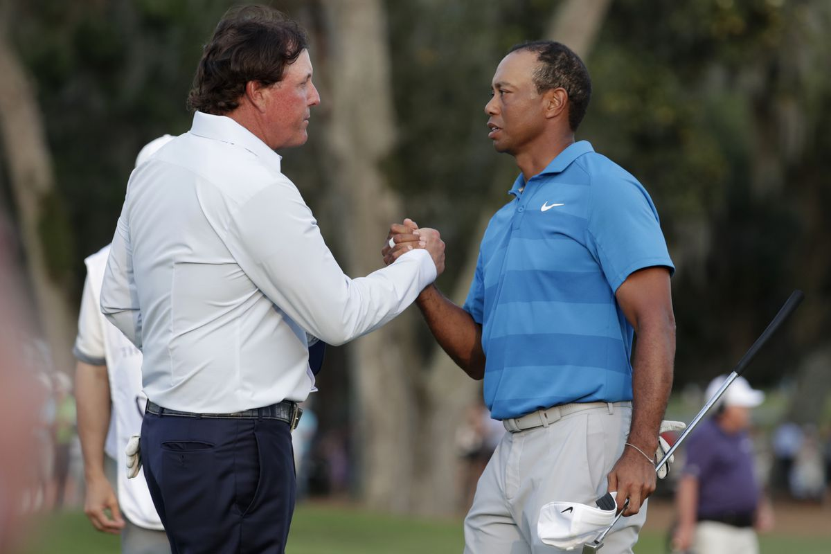Turner Sports says Tiger Woods and Phil Mickeson will join Tom Brady and Peyton Manning for a two-on-two golf match in May.