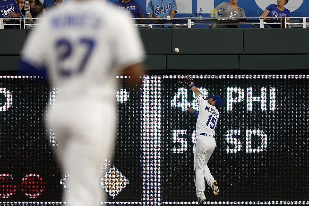 Whit Merrifield #15 of the Kansas City Royals misses a fly ball during the 6th inning of the game against the Boston Red Sox at Kauffman Stadium on June 04, 2019 in Kansas City, Missouri.
