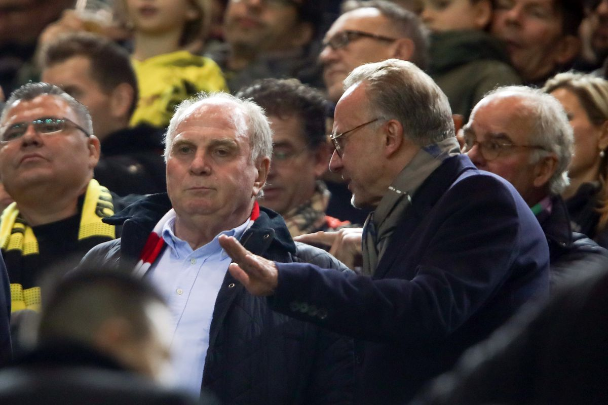 DORTMUND, GERMANY - NOVEMBER 10: President Uli Hoeness and CEO Karl-Heinz Rummenigge of Muenchen discuss prior to the Bundesliga match between Borussia Dortmund and FC Bayern Muenchen at Signal Iduna Park on November 10, 2018 in Dortmund, Germany.