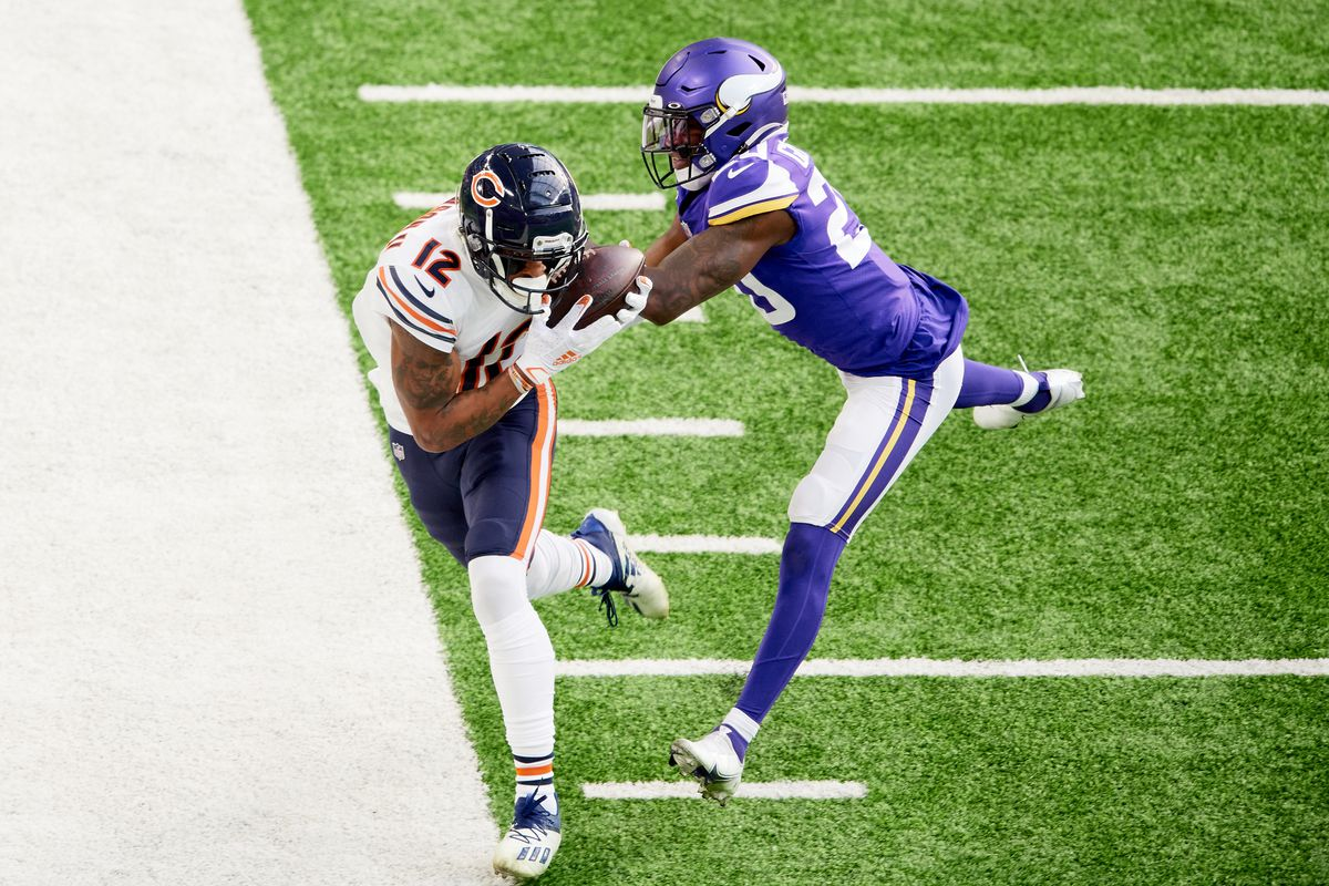 Jeff Gladney #20 of the Minnesota Vikings pushes Allen Robinson #12 of the Chicago Bears out of bounds during the game at U.S. Bank Stadium on December 20, 2020 in Minneapolis, Minnesota.