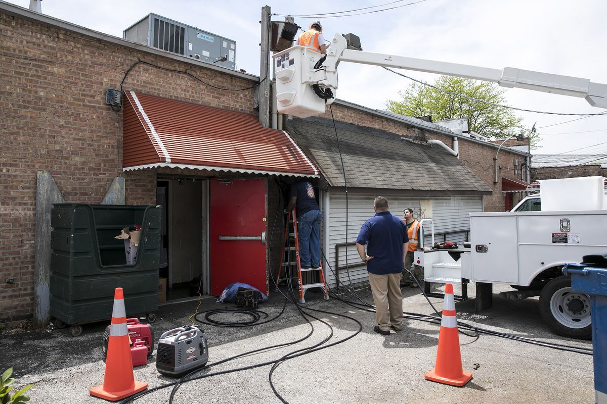 Workers with the International Brotherhood of Electrical Workers Local 134 replace copper wiring and hardware that was damaged during a burglary at Captain's Hard Time Dining, 436 E. 79th St., on Thursday afternoon, May 17, 2018.   Ashlee Rezin/Sun-Times