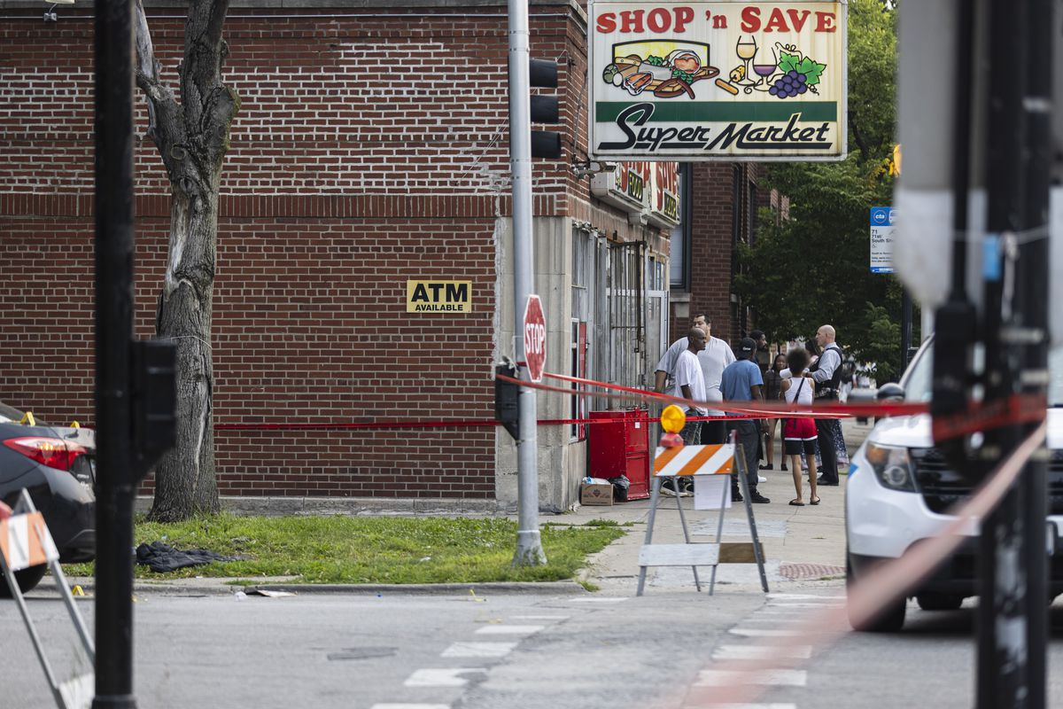 Police investigate the scene at the corner of E 71st St and S Indiana Ave in Park Manor where a 17-year-old was shot and pronounced dead at the hospital, Tuesday, July 20, 2021.   Anthony Vazquez/Sun-Times