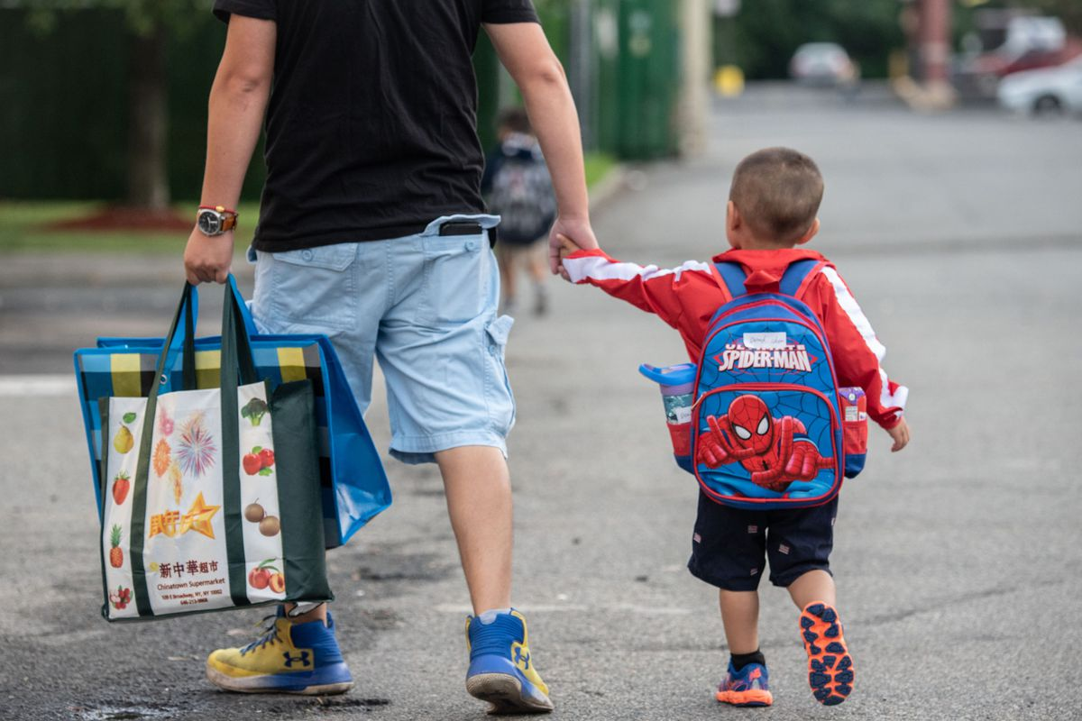 A father brings his child to a Staten Island Pre-K program during the first day of school in 2019. On Wednesday, Mayor Bill de Blasio announced that NYC would tap into federal pandemic relief funds to make preschool universal for 3-year-olds.