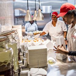 Lunch orders are filled at Hop's Chicken.