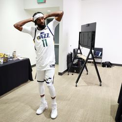Utah Jazz guard Mike Conley (11) has a short discussion with members of the media after being interviewed during the Utah Jazz media media day at Vivint Arena in Salt Lake City on Monday, Sept. 27, 2021.