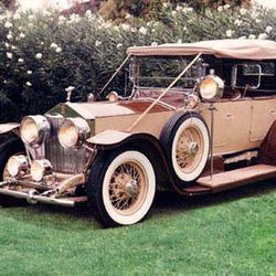 """Rolls Royce: Modern day Rolls Royces are a dime a dozen (err, at least in the rental market). How great would this vintage number fit with a carefully crafted, DIY wedding. Rent one <a href=""""http://www.ejlimo.com/limo-rollsroyce-convertible.php"""">here</a>."""
