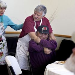 Longtime homeless advocate Pamela Atkinson thanks Ed Snoddy for his years of service as he hugs Joe during the Thanksgiving meal at Grace Mary Manor in South Salt Lake on Tuesday, Nov. 22, 2016.