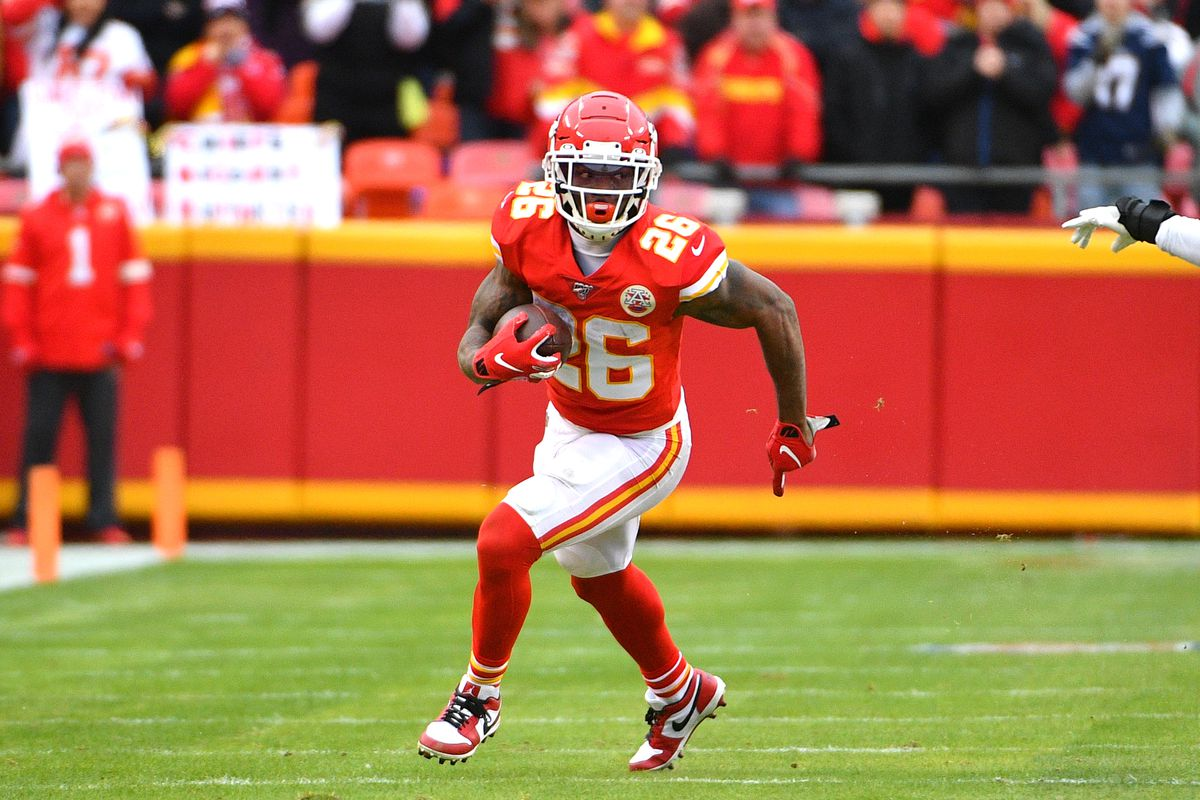 Kansas City Chiefs running back Damien Williams runs the ball during the game against the Los Angeles Chargers at Arrowhead Stadium.