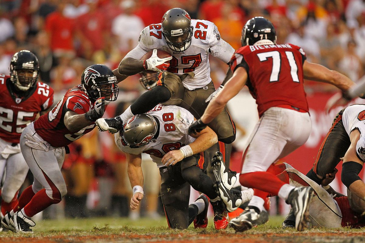 TAMPA, FL - SEPTEMBER 25:  LeGarrette Blount #27 of the Tampa Bay Buccaneers jumps over Luke Stocker #88 during a game against the Atlanta Falcons at Raymond James Stadium on September 25, 2011 in Tampa, Florida.  (Photo by Mike Ehrmann/Getty Images)