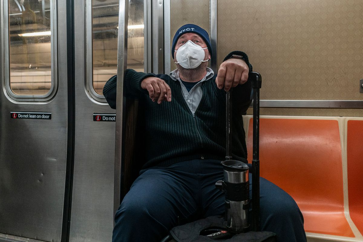 MTA worker Yann Hicks goes home on a Q train, Oct. 30, 2020.
