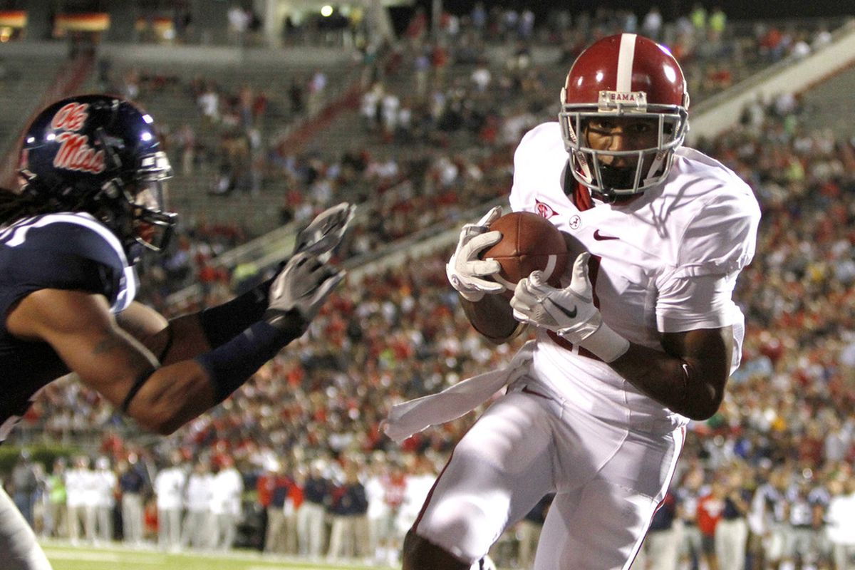 Wide receiver Brandon Gibson (11) of the Alabama Crimson Tide catches a pass for a touchdown against the Ole Miss Rebels in the third quarter on October 15, 2011 at Vaught-Hemingway Stadium in Oxford, Mississippi. (Photo by Butch Dill/Getty Images)
