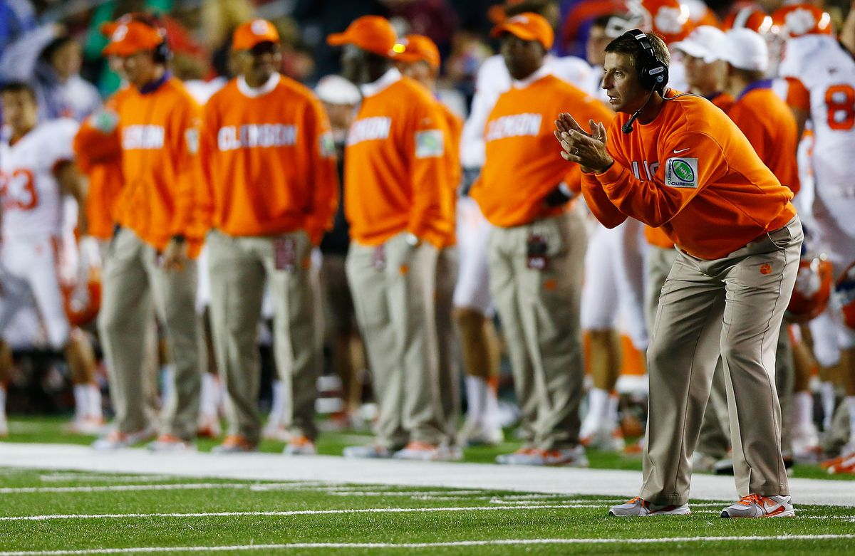 urges  fans orange to Auburn for football wear against game