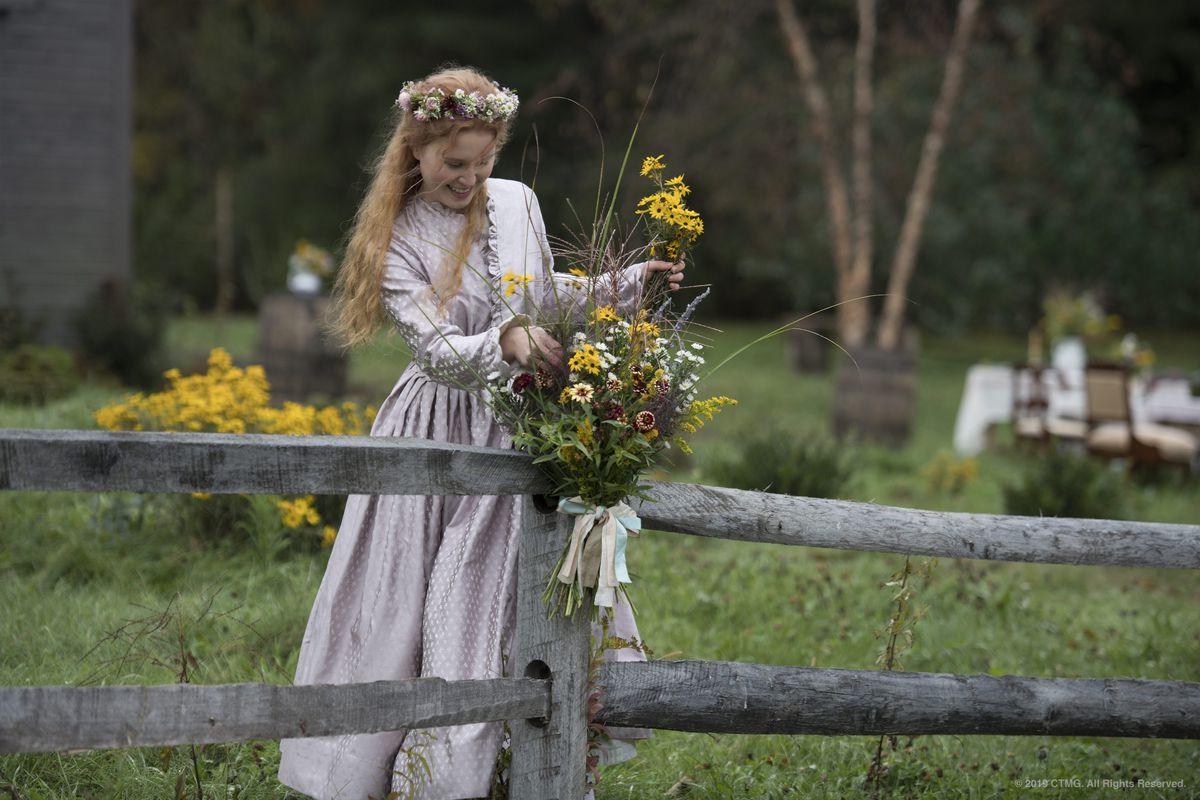Beth gathers flowers in Little Women