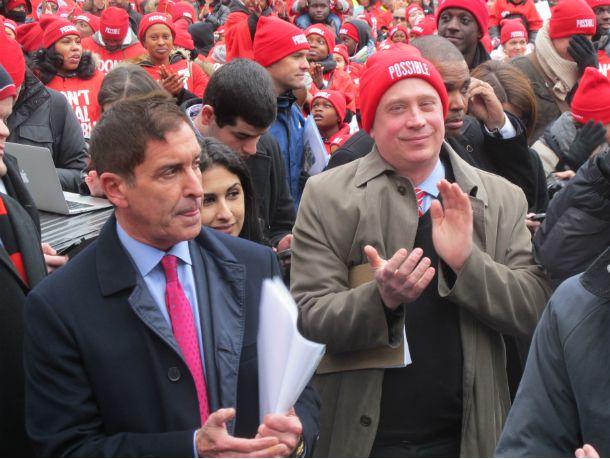 New York City Charter School Center CEO James Merriman applauds speakers at Wednesday's rally.