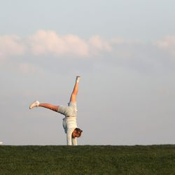 A young girl does handstands as Orem plays Skyridge High School in a high school football game at Skyridge High School in Lehi on Friday, Sept. 3, 2021. Skyridge won 36-0.